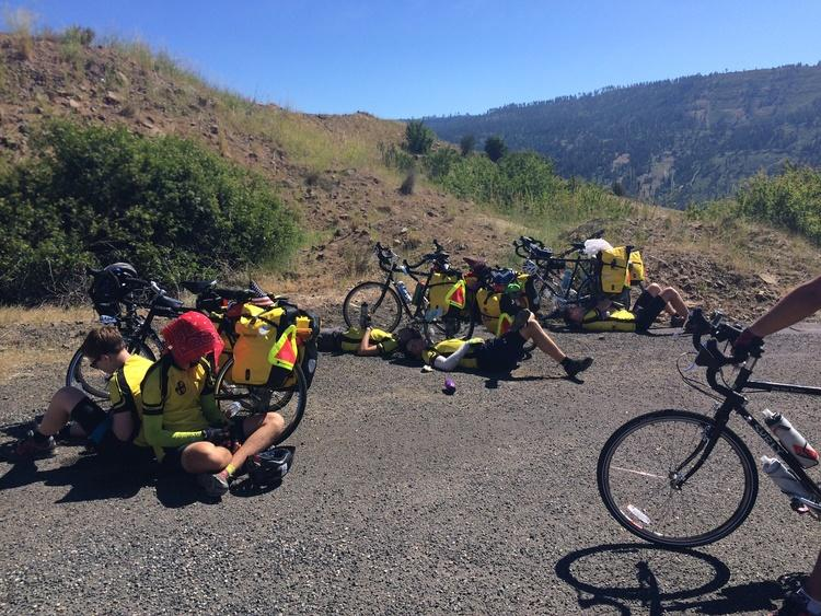 An image of bikers resting alongside the road
