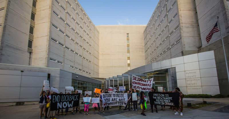 An image of protestors outside Durham Co. Jail
