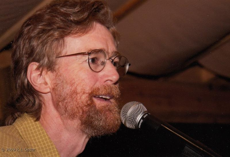 Image of Jamison calling a dance from 2009