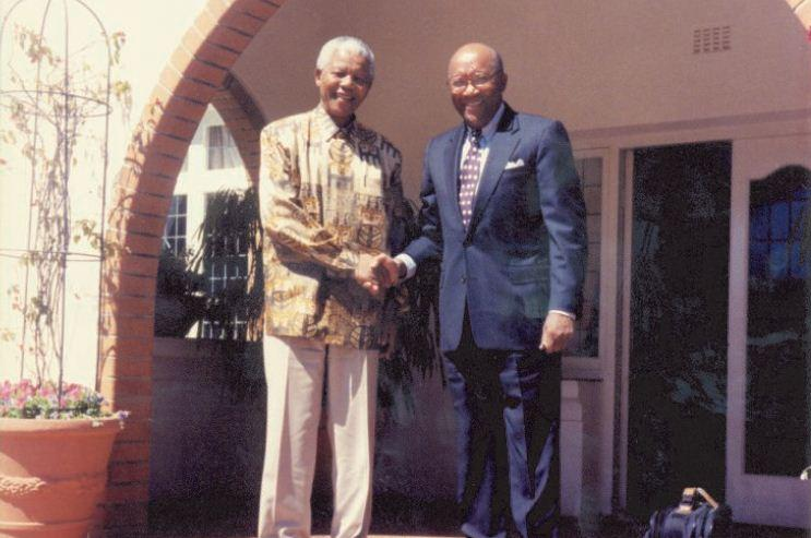 Image of Brown meeting with Nelson Mandela in South Africa at his home in Johannesburg.