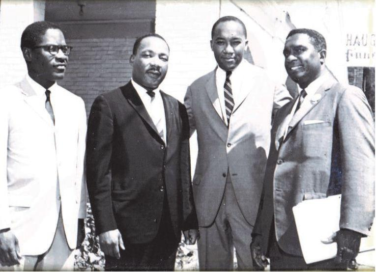 Image of Robert Brown (second from right) meeting with Dr. Martin Luther King Jr., his assistant Bernard Lee and Rev. L.V. Booth.