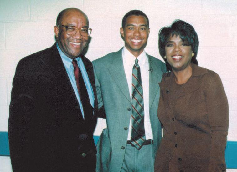 Image of Brown backstage at The Oprah Winfrey Show with Tiger Woods.