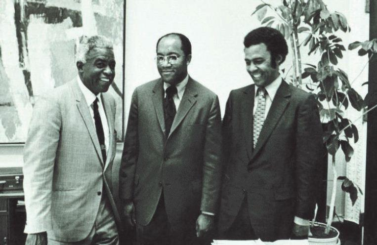 Image of Brown meeting with Jackie Robinson and government official John Jenkins.