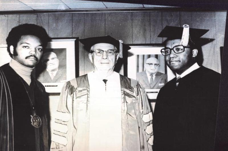 Image of Brown receiving an honorary degree from N.C. A&T along with Rev. Jesse Jackson and the mayor of Greensboro.