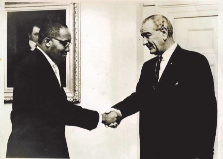Image of Brown being greeted by President Lyndon B. Johnson at the White House.