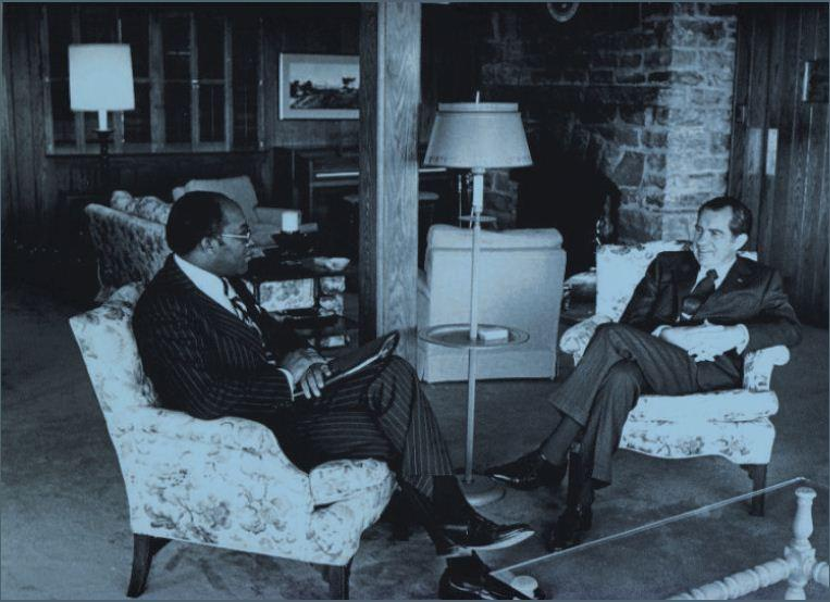 Image of Brown, a former special assistant to President Richard Nixon, meeting with him at Camp David.