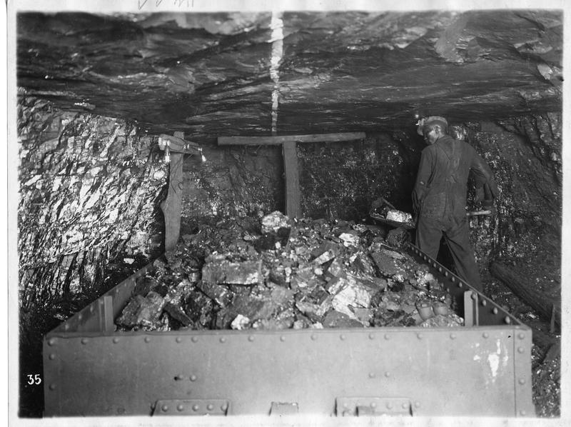 Image of miner loading coal in Portal 31 in Lynch, Ky. in the 1920s.