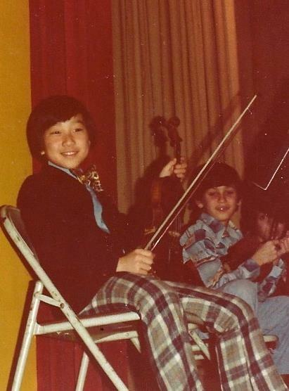 Emil Kang playing violin in fourth grade in 1978