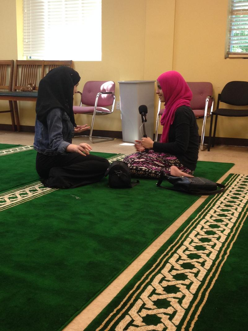 Soraya Asfari interviews another girl about wearing a hijab at her mosque.