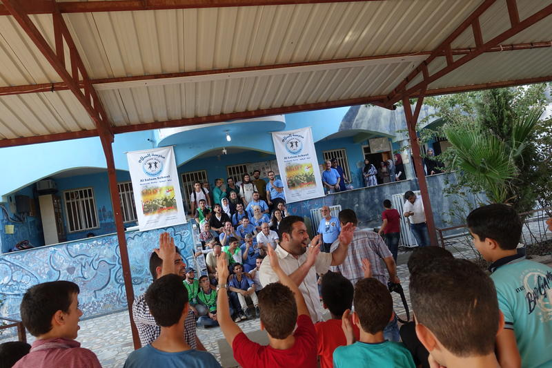 Four days after the volunteer dentists arrived, students from the Al-Salaam School serenaded the American dentists, assistants and students.