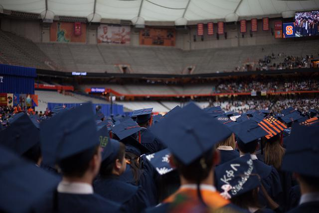 College graduates in 2013 at Syracuse University. Say Yes has another partner community in Syracuse, New York
