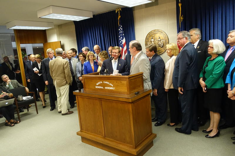 North Carolina House Speaker Tim Moore (center left) and Senate Leader Phil Berger (center right), flanked by top Republicans from the House and Senate, outlined on Monday afternoon a tentative deal for North Carolina's $21.7 billion budget.