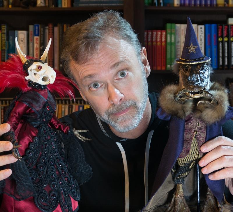 Author Christopher Moore poses with two 'meat puppets'.