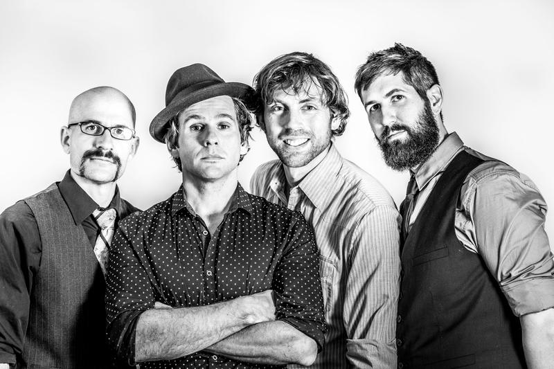 The Steel Wheels are an Americana roots band from Virginia featuring (L-R) Brian Dickel on bass, Trent Wagler on guitar and banjo, Eric Brubaker on fiddle and Jay Lapp on mandolin.