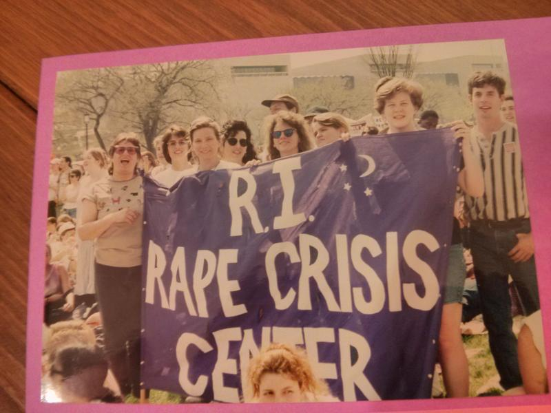 Melissa Radcliff joins with staff and volunteers from the Rhode Island Rape Crisis Center in holding the agency's banner at the NOW rally in Washington, D.C. in April 1995.