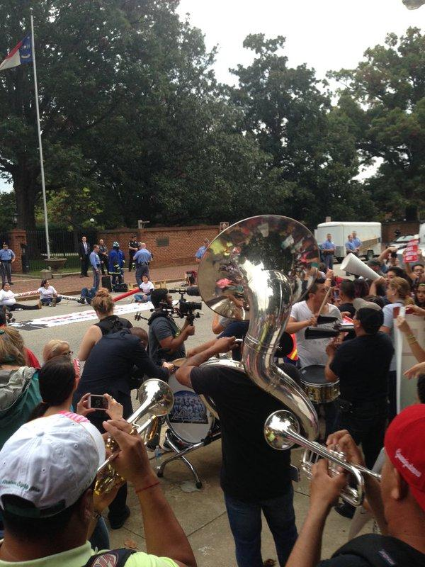 Some people danced as a band with brass, horns and percussion sections joined them. More than 200 people protested a new immigration-related law outside of the North Carolina Executive Mansion.