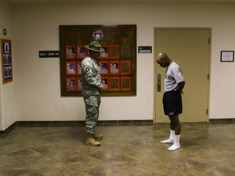 A drill sergeant reprimands one of the recruits