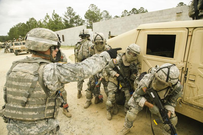 Army recruits simulating combat situations