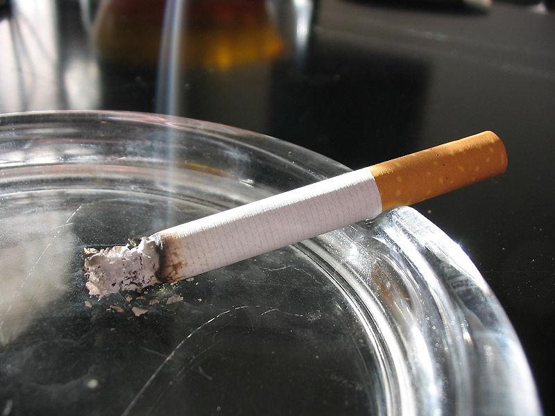 A cigarette in an ashtray.