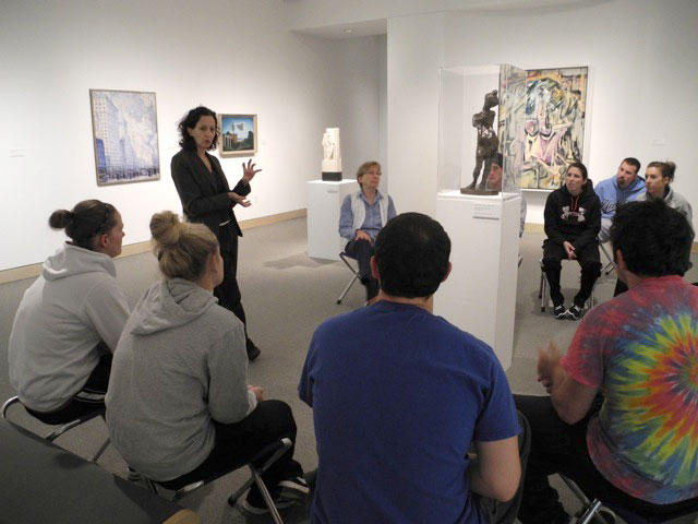 Ann Grimaldi (standing) leads one of the 'Art of Seeing' workshops.