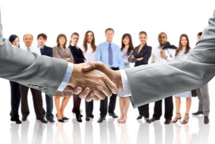 An image of a handshake on an isolated business background