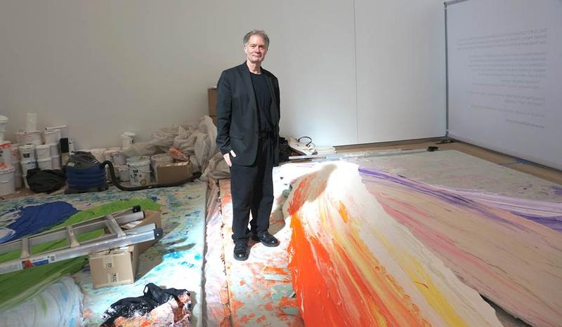 And image of Chapel Hill artist Donald Martiny standing between two paintings at the World Trade Center