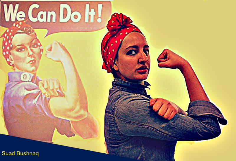 Photo of Composer Suad Bushnaq dressed up as 'Rosie The Riveter' for Halloween.
