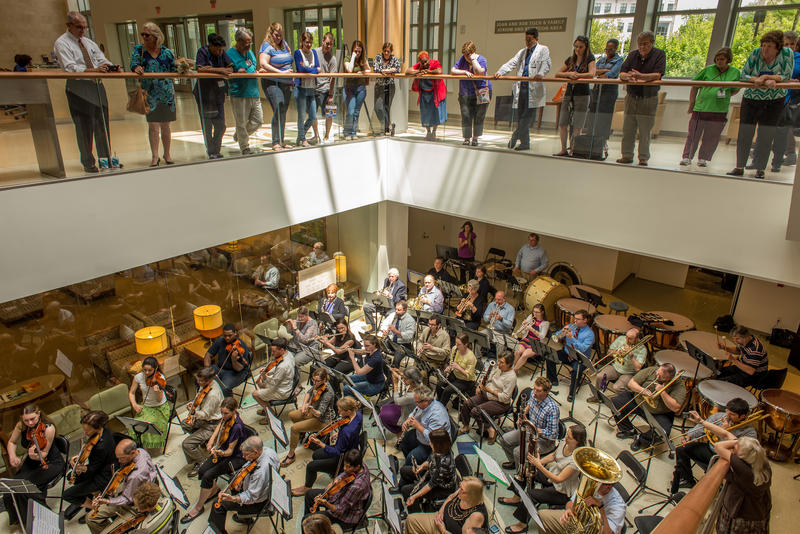 Duke Medicine Orchestra held a concert in the Duke Cancer Center for patients and families, shown here in May 2014.