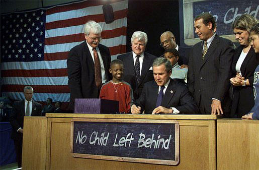 George W. Bush signs the No Child Left Behind Act in 2001.