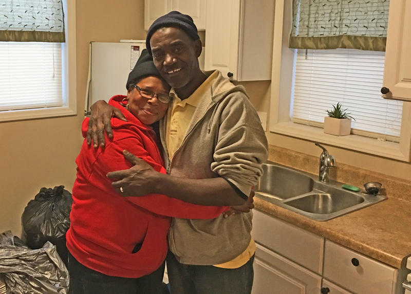 Jamie Jones hugs her husband, Army veteran James Wallace, as they move into their new Winston-Salem duplex apartment.
