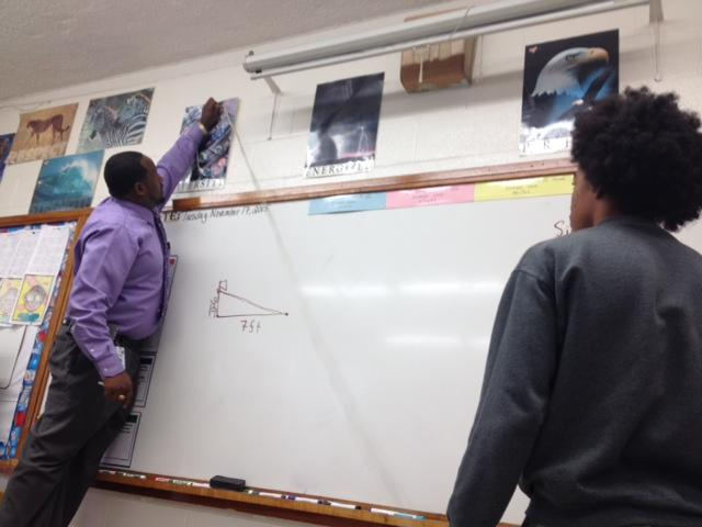 Fayetteville math teacher Kenneth Williams creates a life-sized right triangle in his classroom.