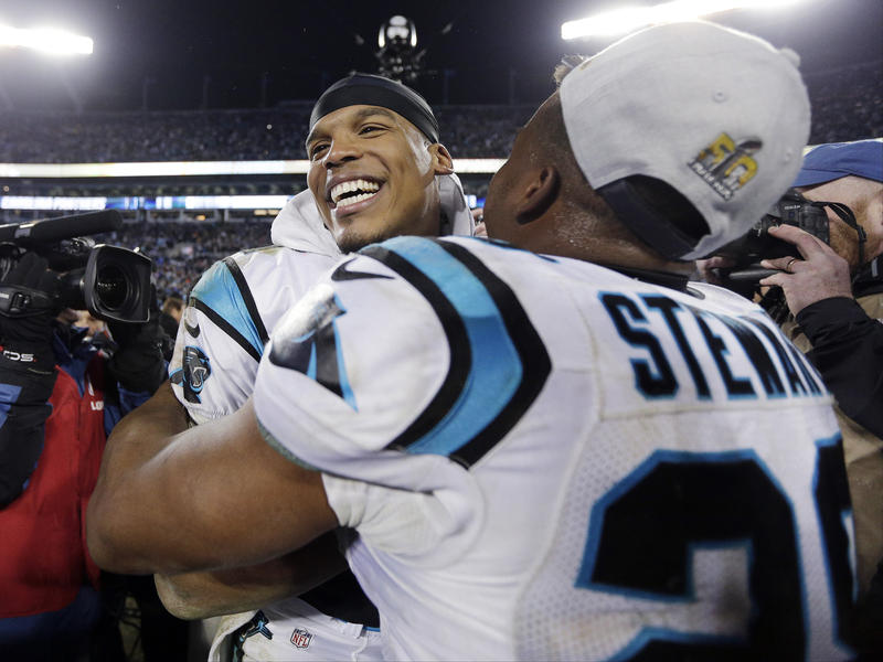 Carolina Panthers' Cam Newton celebrates with Jonathan Stewart after the NFL football NFC Championship.