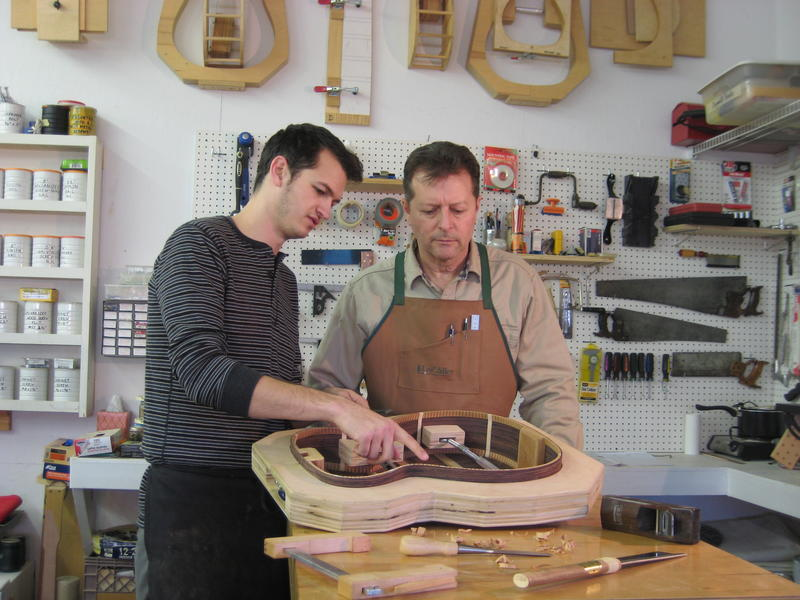 Alex Edney (L) and Terry Fritz (R) discussing the bracing on the sides of a guitar.