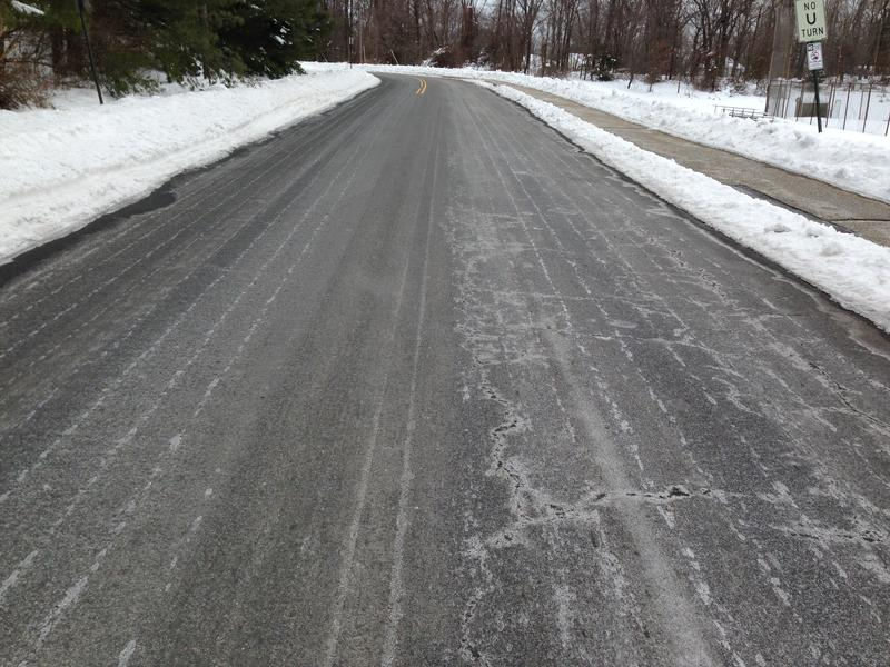 Salt brine sprayed and dried on a road surface for anti-icing before a snow storm