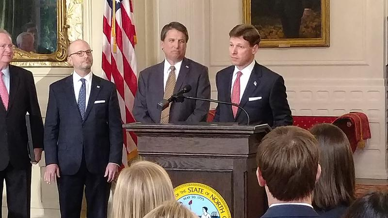(Left to right) Lyons Gray, Jeff Epstein, Governor Pat McCrory, Lee Roberts. Gray is the outgoing Secretary of Revenue; Epstein will take over in February; Roberts is returning to the private sector after 18 months in the McCrory administration.