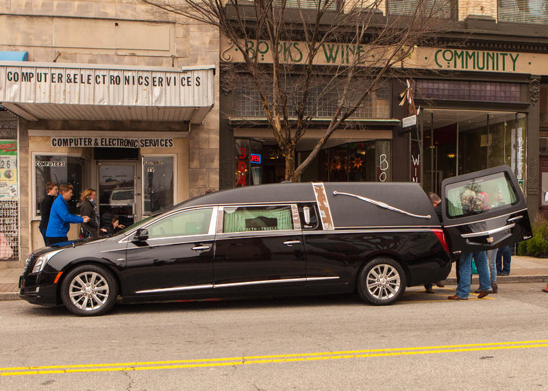 A hearse from Lambeth-Troxler Funeral and Cremation Services donated and brought the cremation casket to Scuppernong Books, where the party for Stimp Hawkins was held.