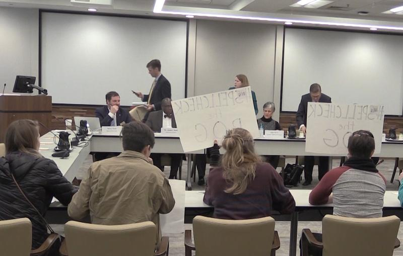 Protesters take over board members' seats at the UNC Board of Governors meeting in Chapel Hill.