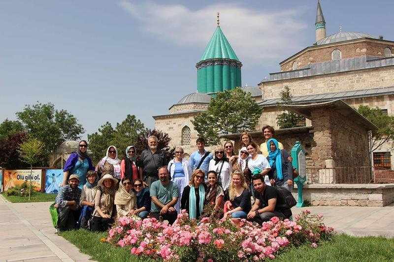 Image of Omid Safi with students on a trip