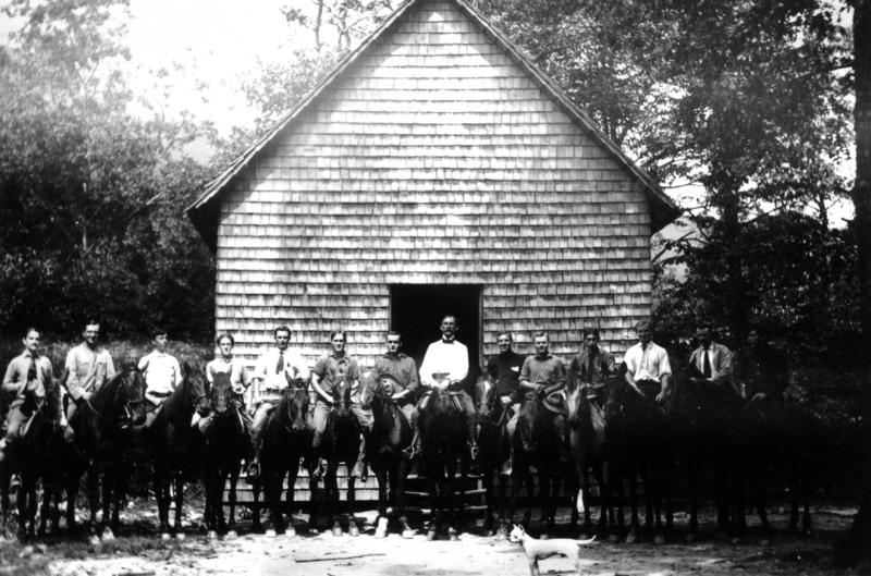 Carl Schenck and students on horseback in front of the school building