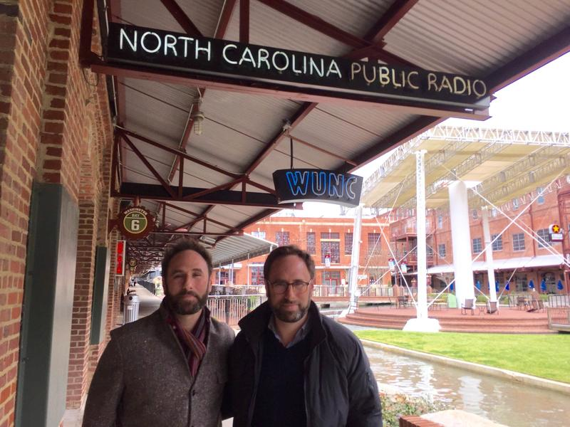An image of the Sklar brothers in front of North Carolina Public Radio