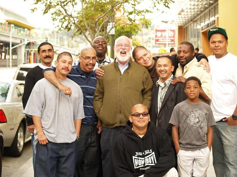 More than two decades ago Father Greg Boyle (middle) founded 'Homeboy Industries,' the largest gang-internvention program in the country. Here he is on Thanksgiving day in 2012 at Homeboy Industries in Los Angeles.