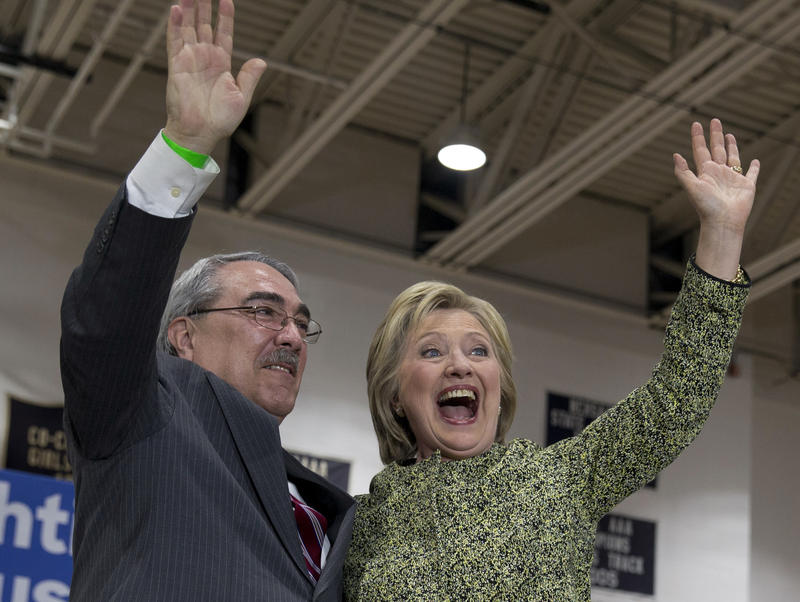Congressman GK Butterfield poses with Hillary Clinton.