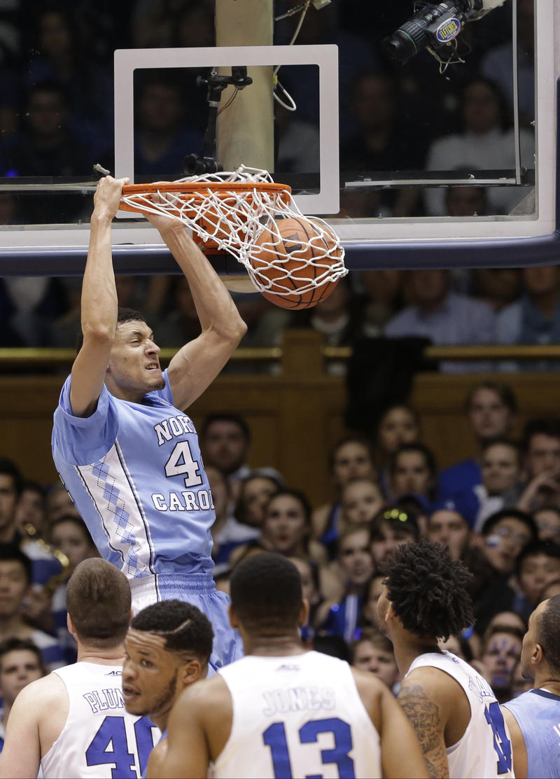 North Carolina's Justin Jackson dunks.