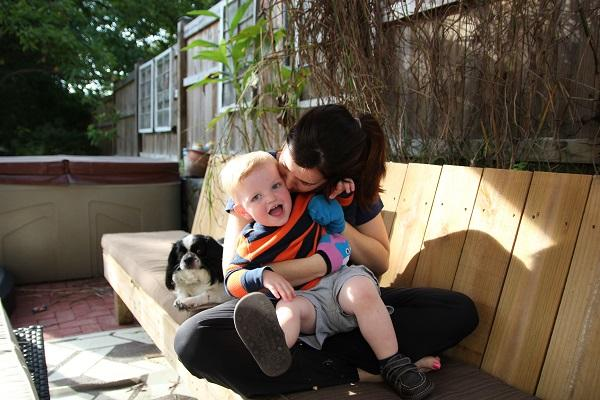 Image of scholar Kate Bowler with her 2-year-old son