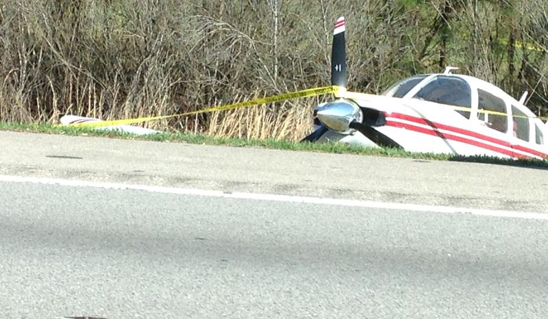 A picture of the plane on the roadside.