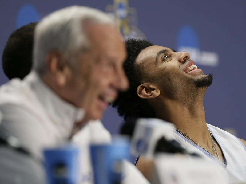 North Carolina's Joel Berry II, right and head coach Roy Williams laugh during a news conference