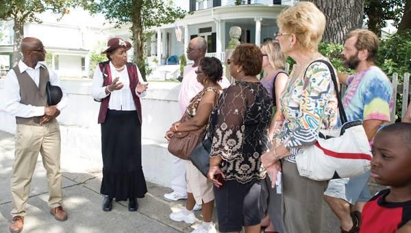 Leesa Jones and her husband Milt hosting a tour group through Washington's historic district where African Americans lived and owned businesses in 1828.