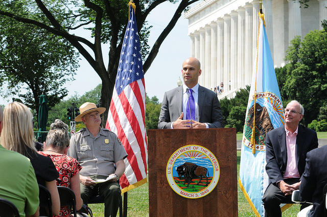 Let's Move! Executive Director and White House Senior Policy Advisor on Nutrition Sam Kass speaks at a 2013 event with the National Parks Service and the Department of the Interior.