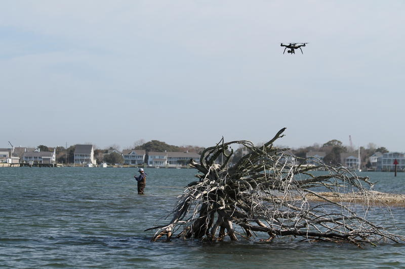 Drones flying above the water.