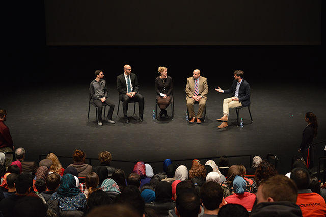 Host Will McInerney moderates a panel after a performance of 'Shattered Glass' with poet Mohammad Moussa, Farris Barakat, Dr. Anna Bigelow, and Dr. Muhammad Abu Salha.